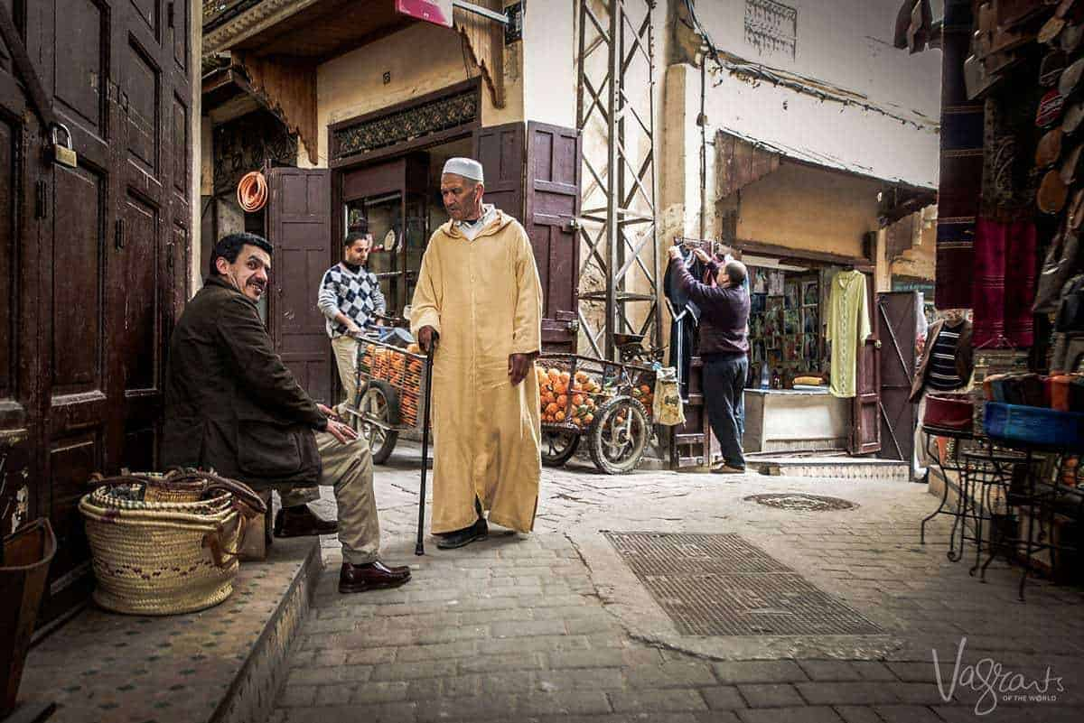Man in traditional dress walking through Fez Medina