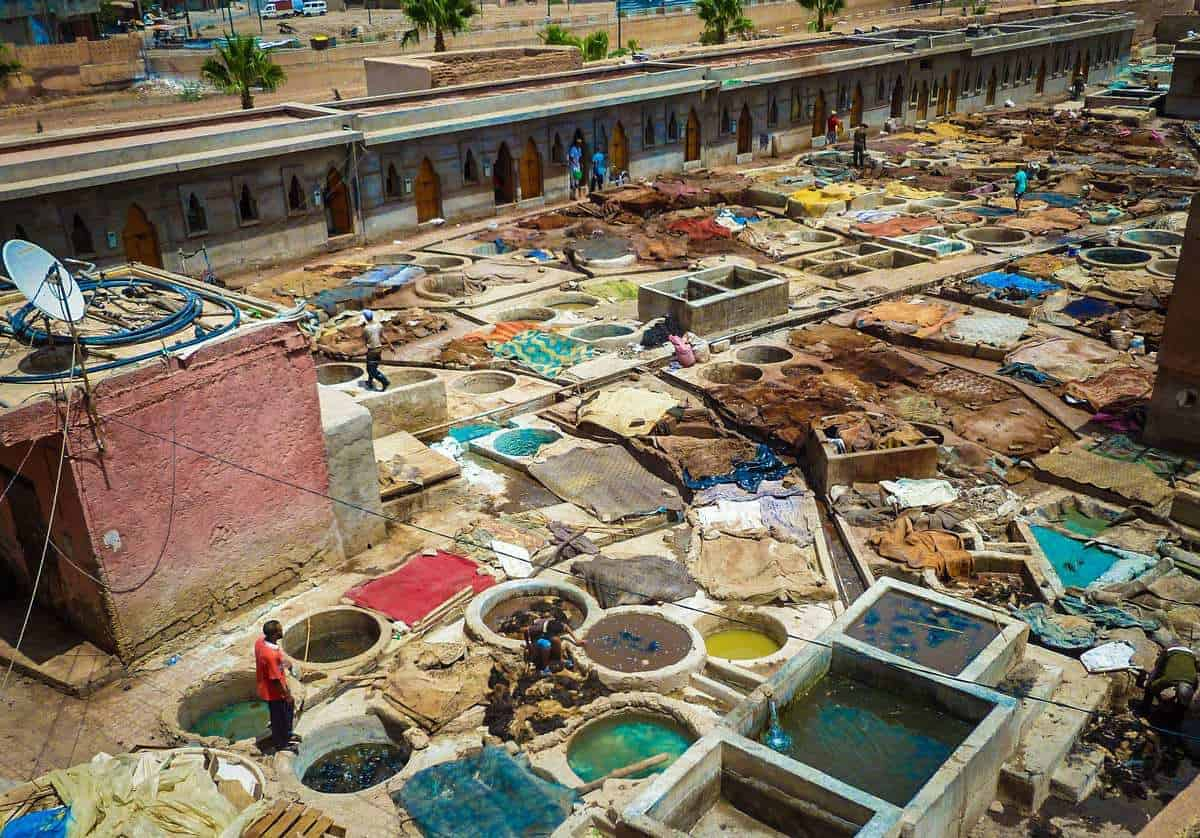 Tannery ponds and workers Morocco. Best free things to see and do in Marrakech Morocco