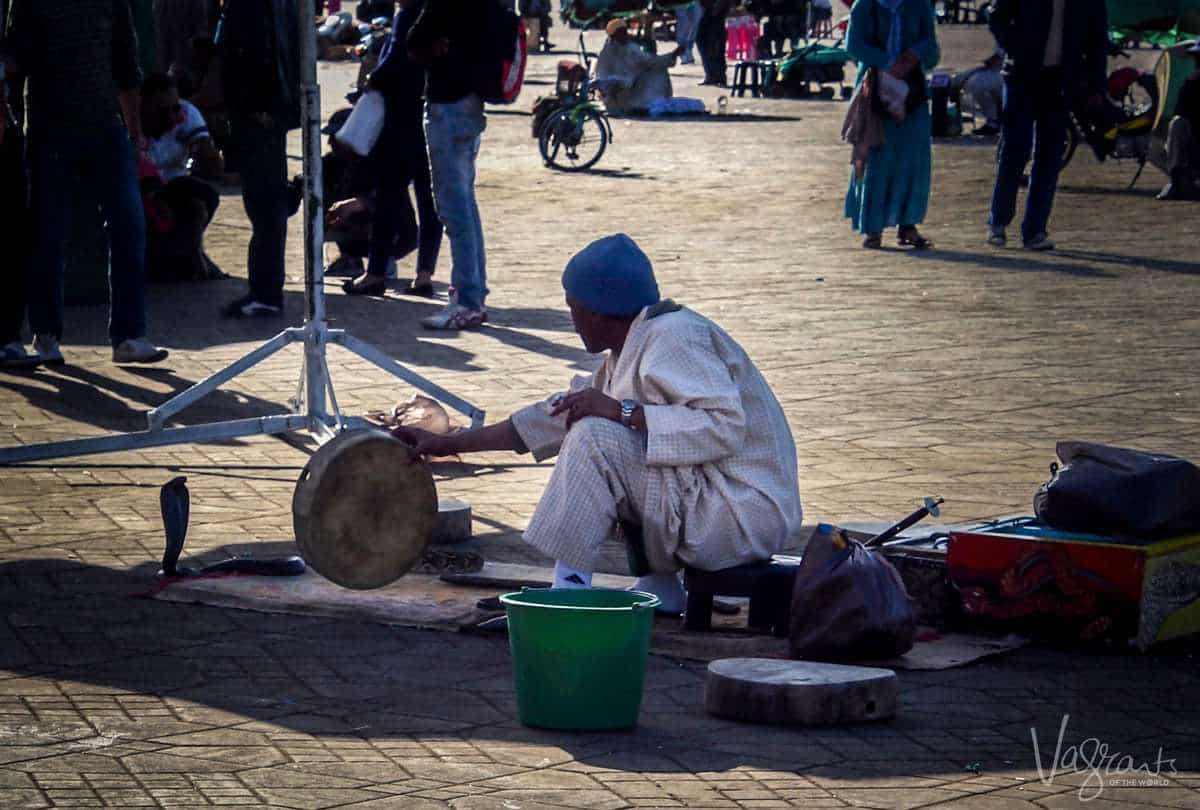 Snake charmer at Jemaa el-Fna Marrakech Morocco. Is Morrocco safe. Beware of pickpockets in Marrakesh. Beware of scammers in Marrakesh.
