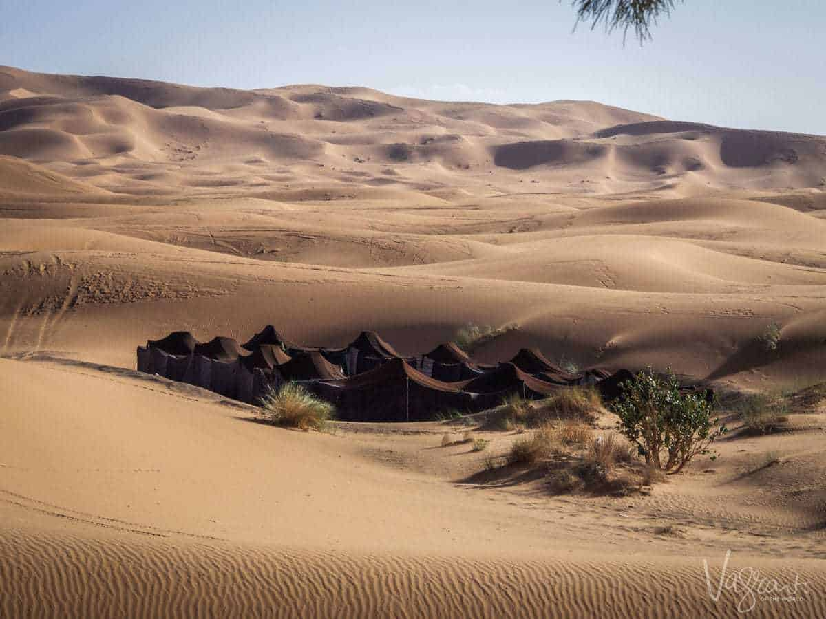 A guide to a road trip in Morocco Marrakech toFez - A Berber Camp, a cluster of brown tents nestled amongst the sand dunes in the Sahara Desert Morocco