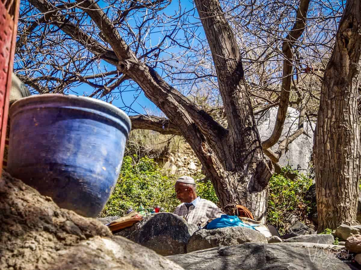 Local Berber man drinking coffee in the Middle Atlas Mountains Morocco