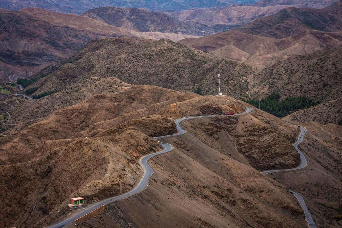 Moroccan road trip Marrakech to Fez Crossing the high Atlas Mountains along a windy road which sits atop the mountain ridges.
