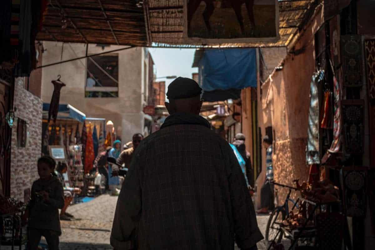dark back of man in Marrakech Medina morocco. Is Morrocco safe. Beware of pickpockets in Marrakesh