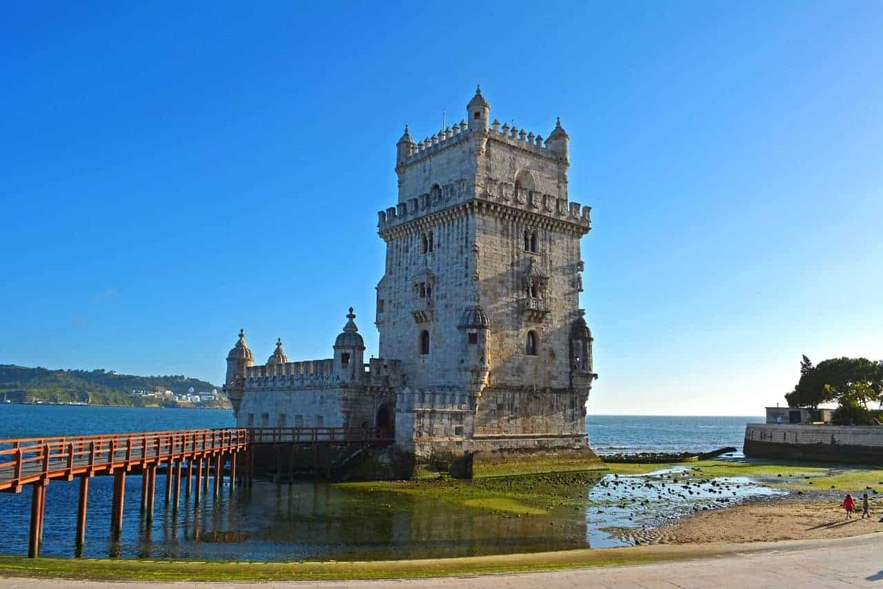bridge out to Belem Tower surrounded by water. Best things to see and do in lisbon