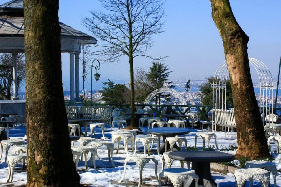 outside dining tables and chairs sitting in the snow at Camlica Hill. Istanbul Turkey