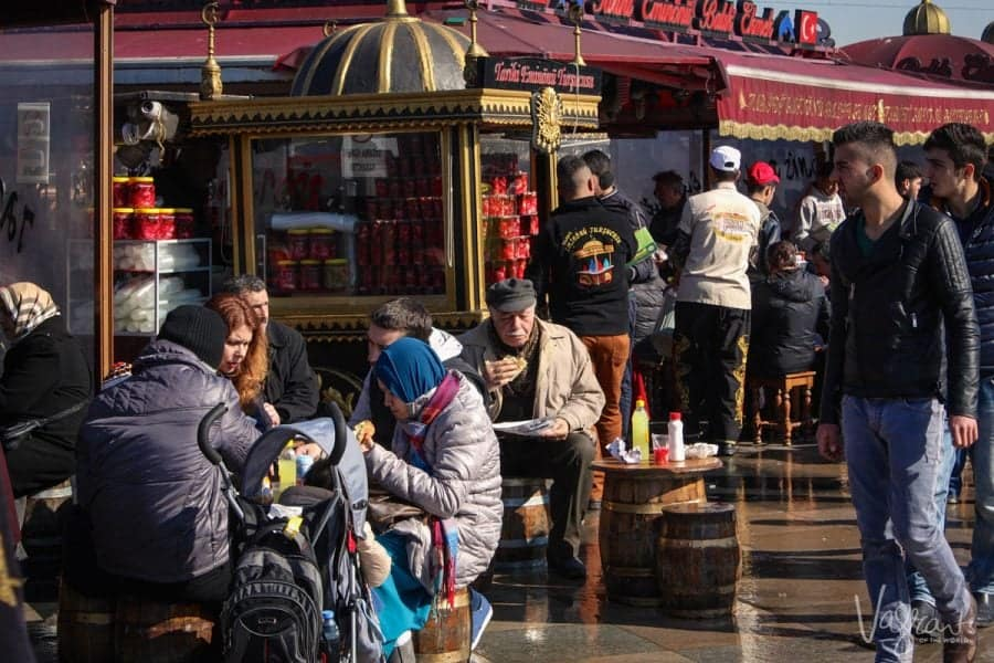 people eating fish on bread at Eminönü, Istanbul Turkey, Fish Boats. this is where to go in istanbul if you want great food.