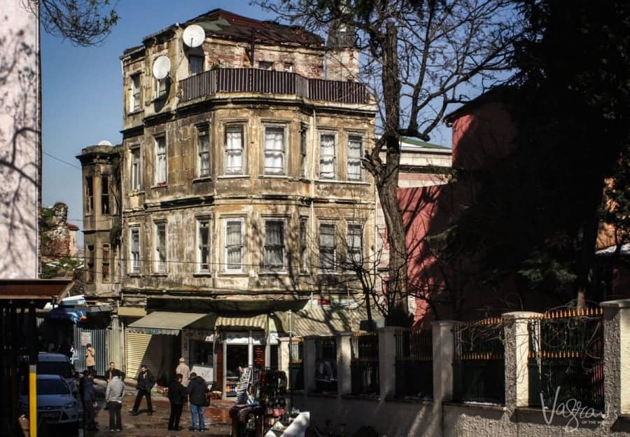 old building with men standing around out the front chatting in the Fener District Istanbul Turkey. this is not one of the top 10 things to do in istanbul but worth a visit if you have time