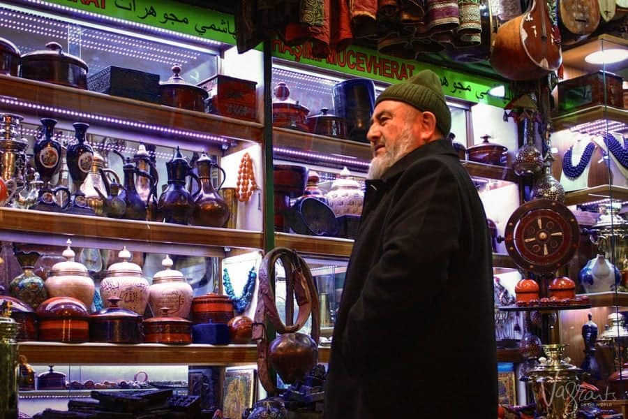 turkish man selling vases in the Grand Bazaar Istanbul. best places to shop in istanbul and one of the top 10 things to do in istanbul