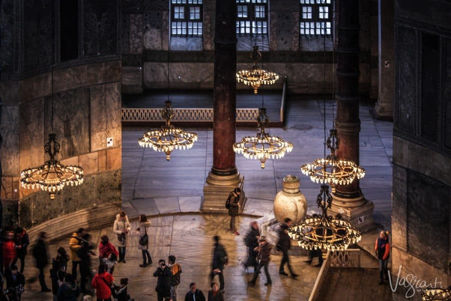 looking down through the chandeliers at the people walking around the Hagia Sophia, Istanbul, Turkey. This is number one thing to do in istanbul and is a major istanbul attraction for all ages