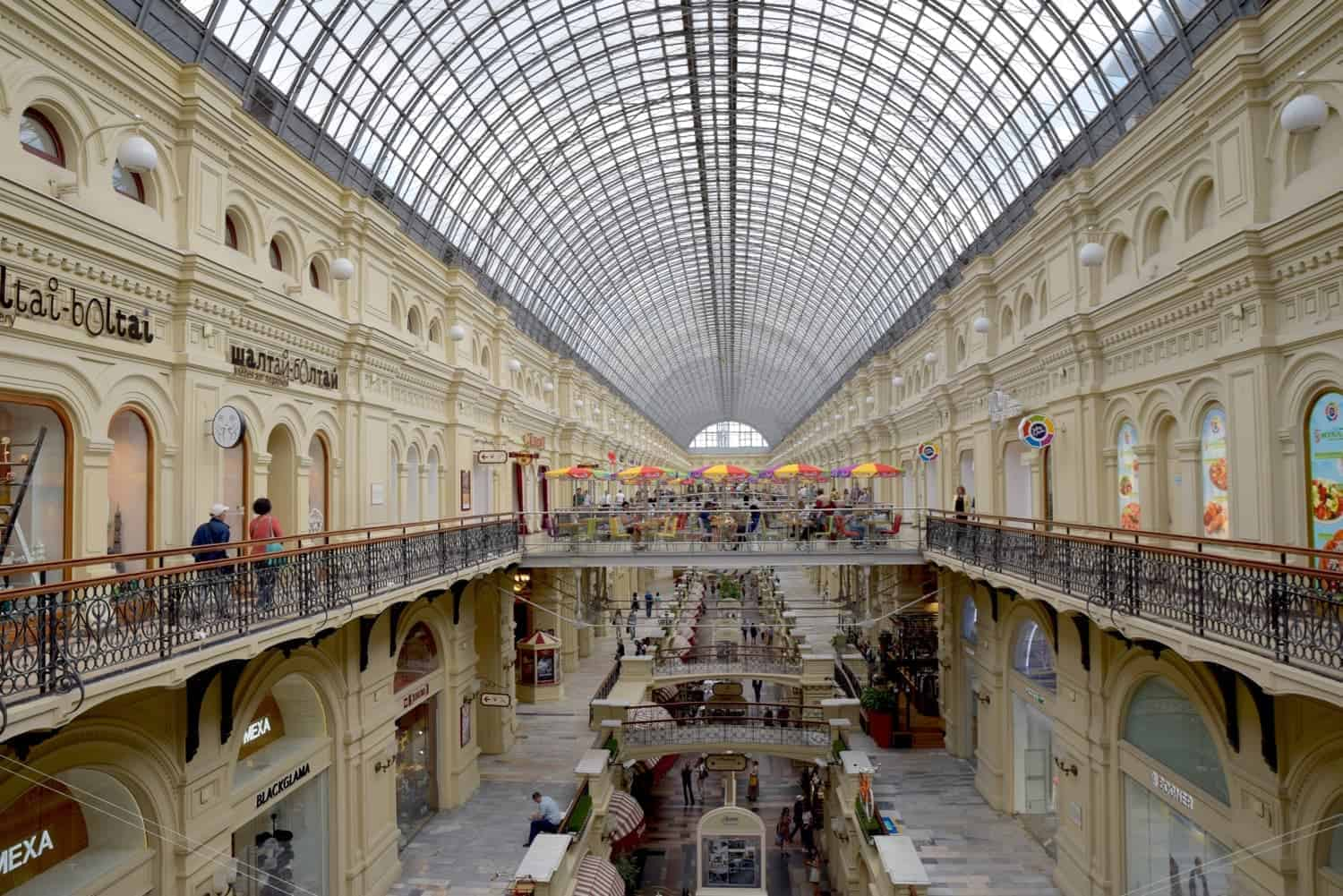 Inside GUM Department Store Russia with 2 levels of shopping in this ornate bulding. The glass domed roof tops the GUM department store one of the most famous places in russia