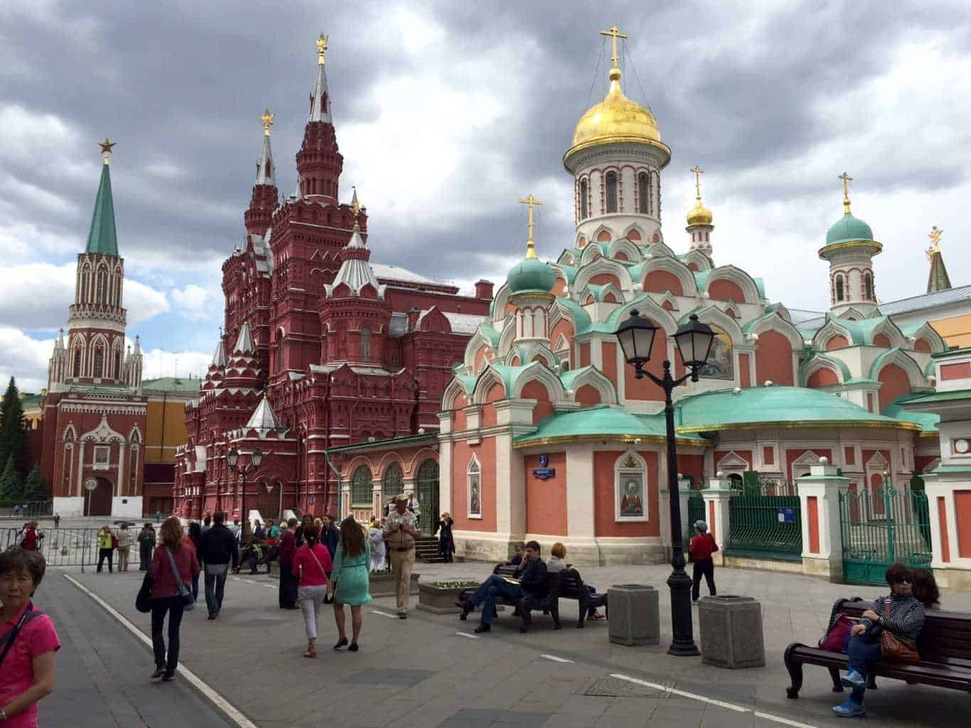 Red Square Moscow Russia with the Kremlin and church of christ the saviour. These are the places are the reason why you should go to moscow. This is a photo of people walking towards two great moscow tourist attractions