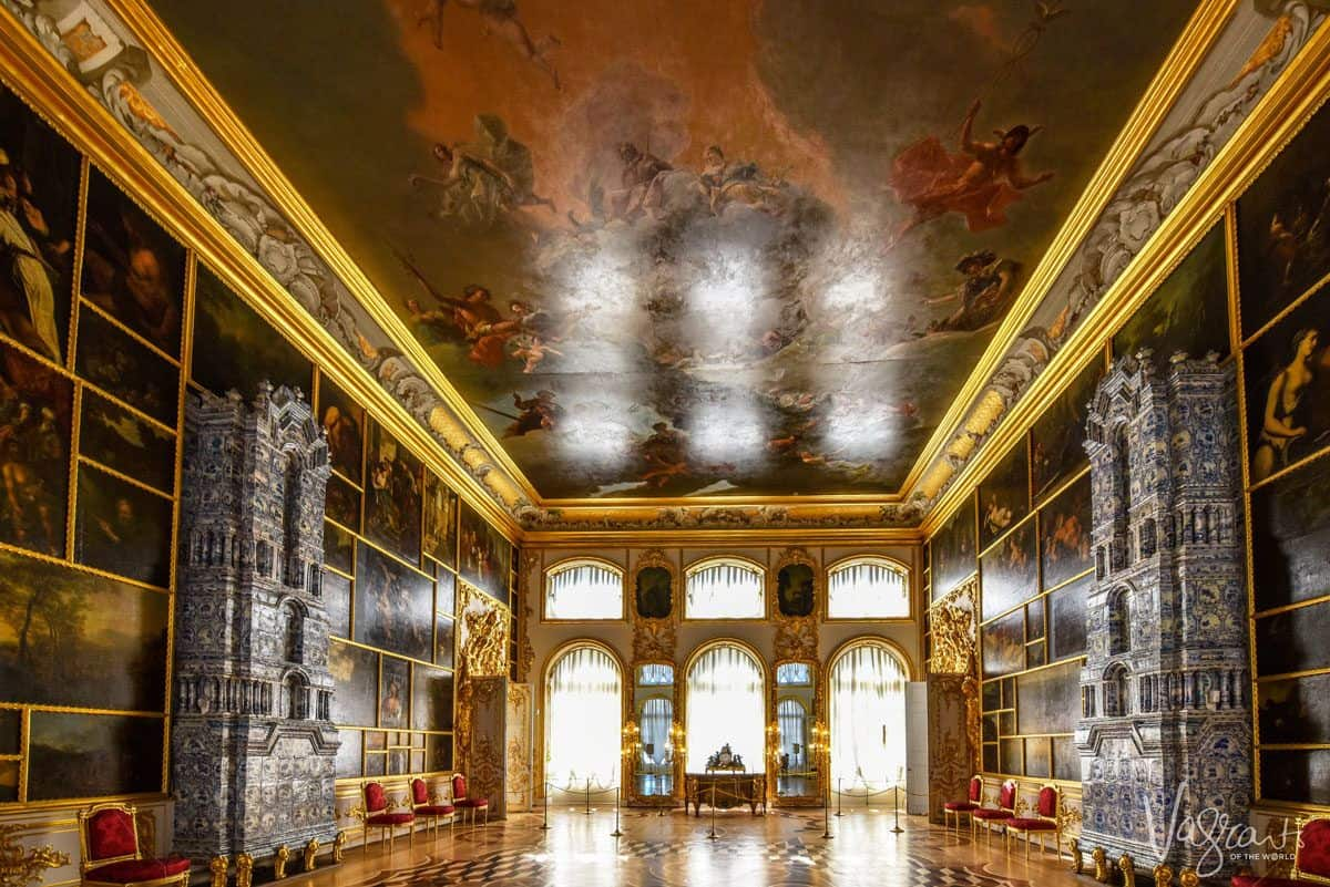 Paintings line the wall and ceiling of this grand room in the Catherine Palace. there are plenty of hidden gems in st Petersburg and the palace is a must for your russian itinerary.