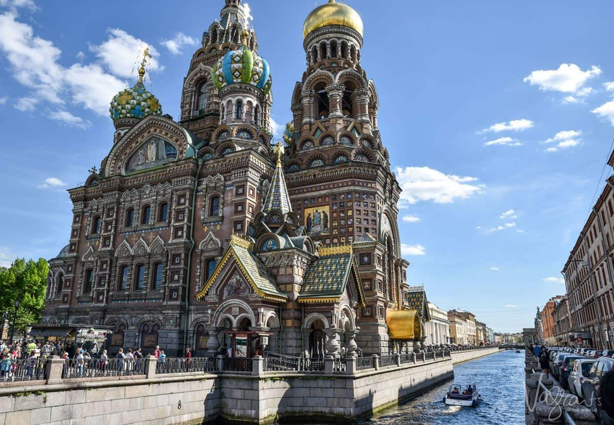 Canal boat cruising past the church on spilled blood. best way of getting around st petersburg may be by canal boat.