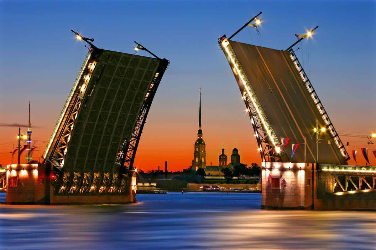 An open bridge during the white nights celebrations in St Petersburg. The white nights celebrations are the best things to do in St Petersburg at night but only in summer.