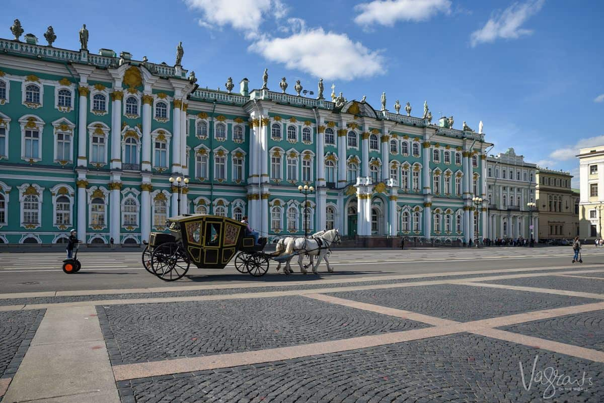 Horse and carriage outside the Hermitage, a fun thing to do in St petersburg is to go on a horse and buggy ride.