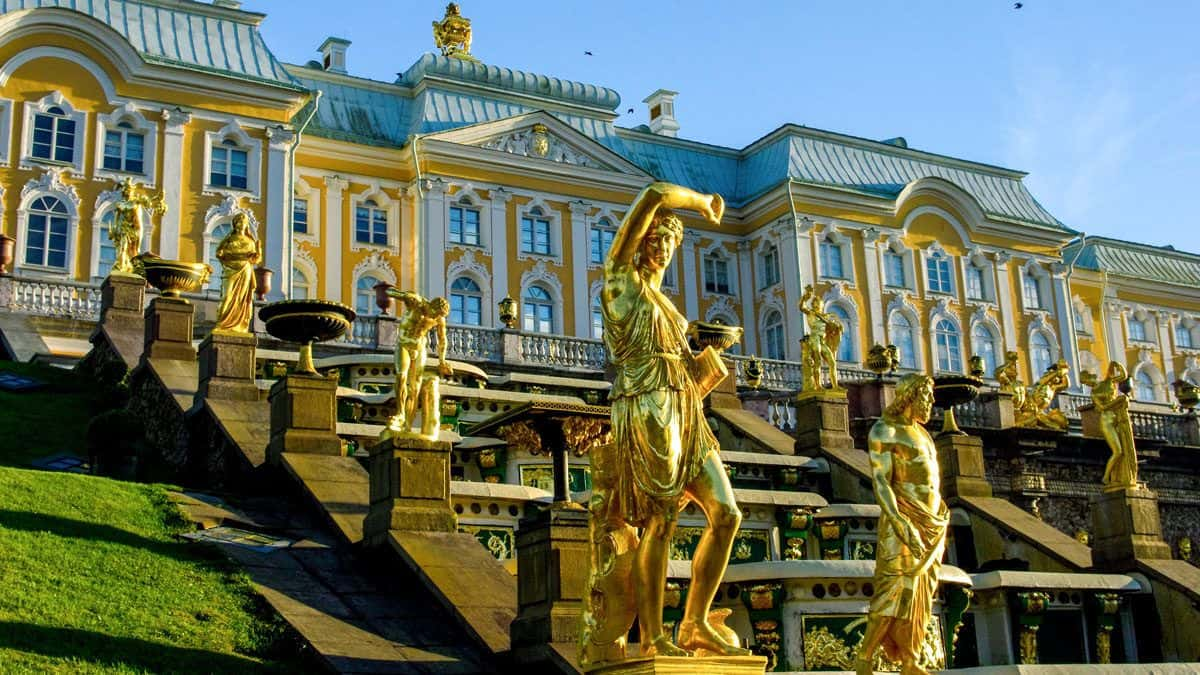 Golden statues of men line the walls leading up to Peterhof Palace. One of the best things to see in St Petersburg.
