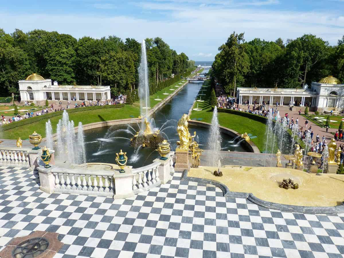 The fountains of Peterhof palace and the black and white checkered forecourt. The best time to visit St petersburg is summer when everything is alive including the fountains.