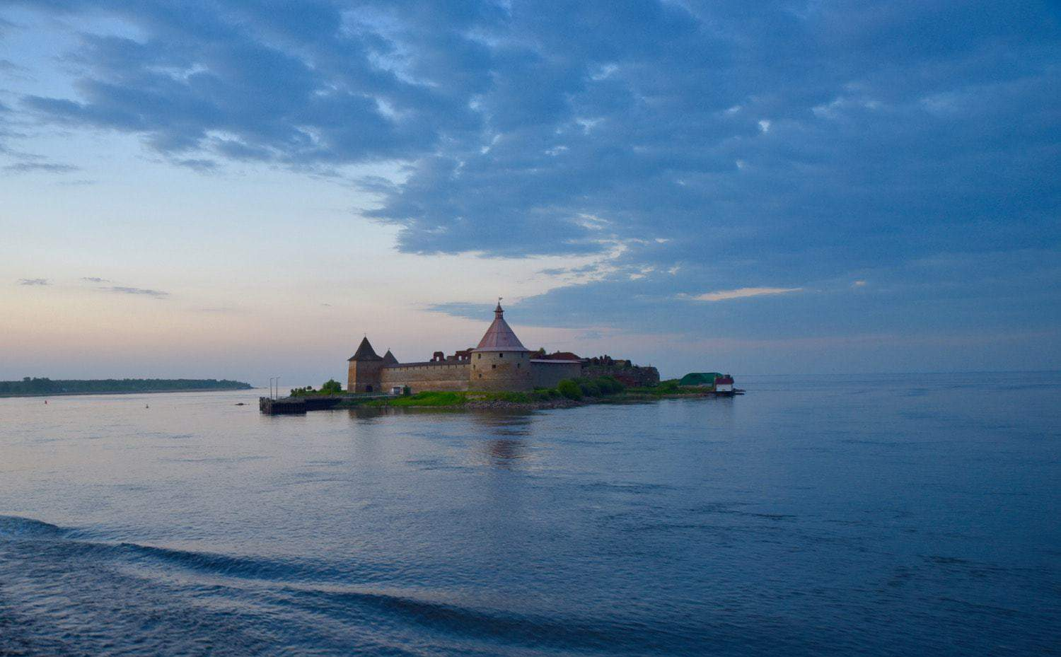 Fortress of Schlusselburg Russia which sits in the middle of a lake.  best things to do in russia is to cruise past these unique russian places to visit