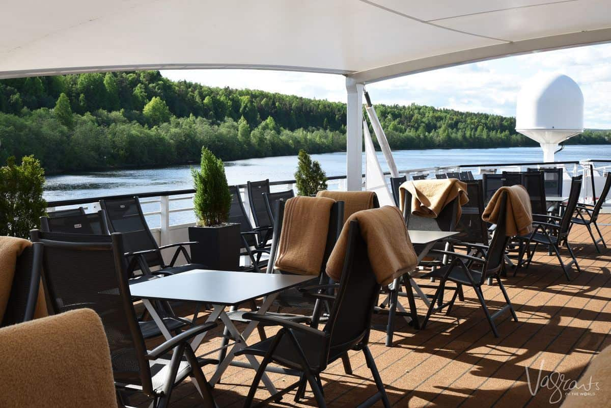 viking river cruise boat deck with tables and chairs.  luxury cruising through russia on a viking river cruise st petersburg to moscow