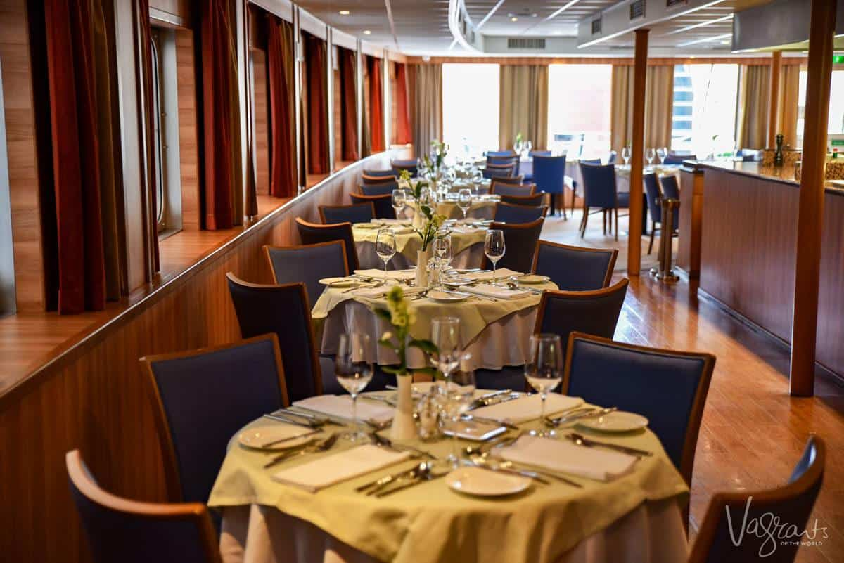 set dining tables on a viking river cruise where you will get the finest russian food on your river cruise in russia