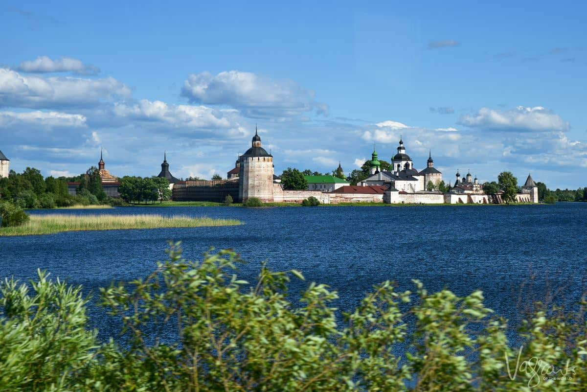 the Kirillo - Belozersky Monastery set against the river with 5 steeples around the outer perimeter.