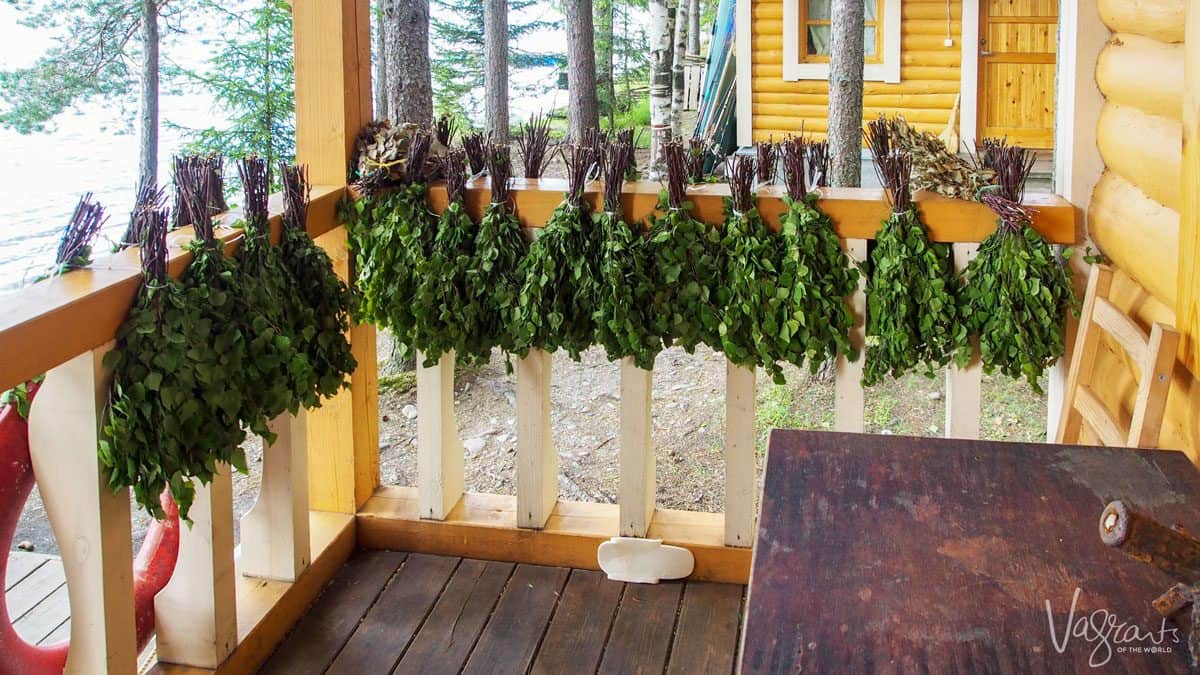 branches tied together and hanging on a rail waiting to be used to whip the hell out of you in a russian banya. viking river cruises will stop here and allow you to be beaten to a sweating pulp by local russian folk