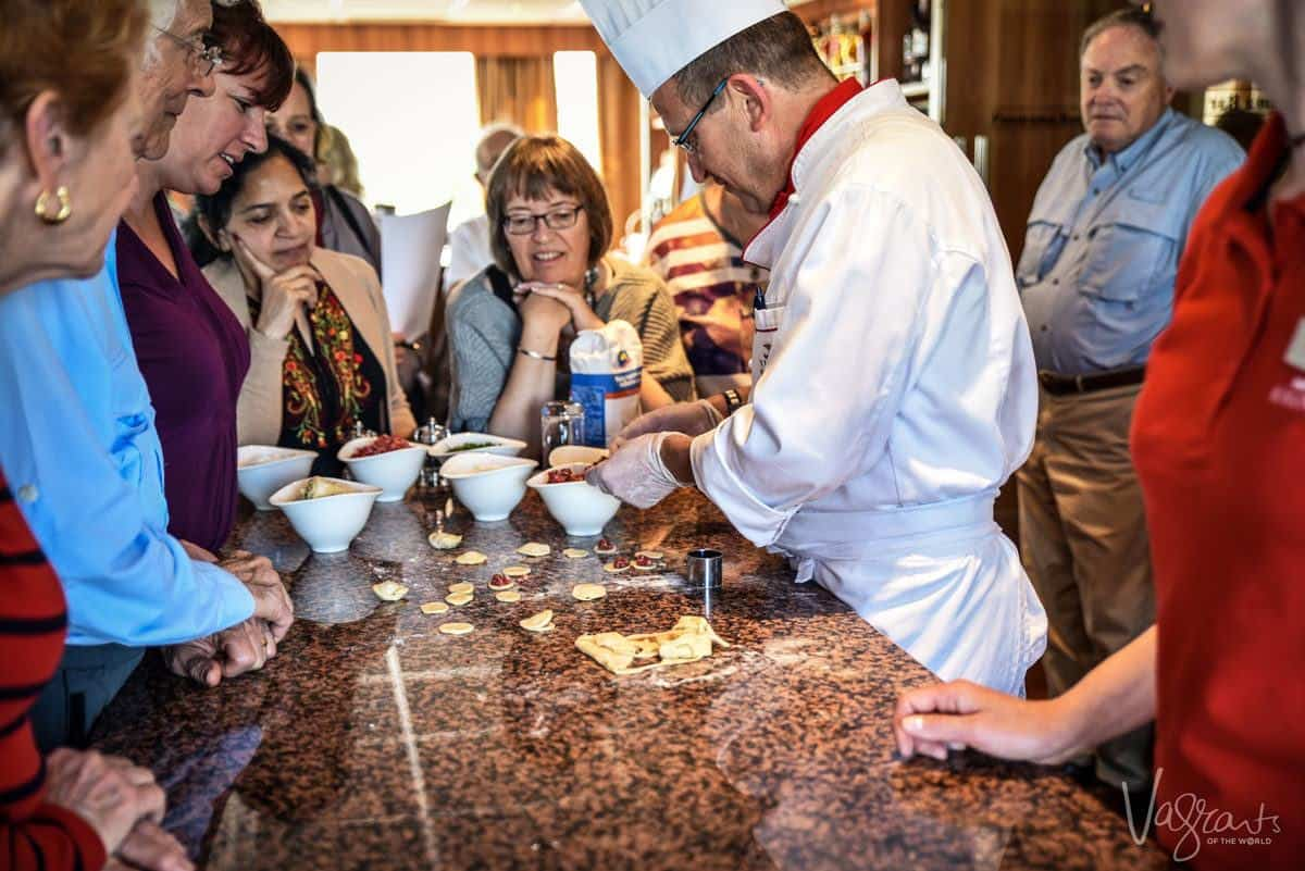 chef showing viking river cruisers how to make a typical russian dish on their cruise st petersburg to moscow