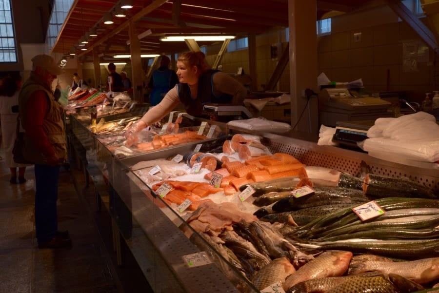 Lady selling fresh fish in The Central Market Riga, Latvia. Best place to eat in Riga.