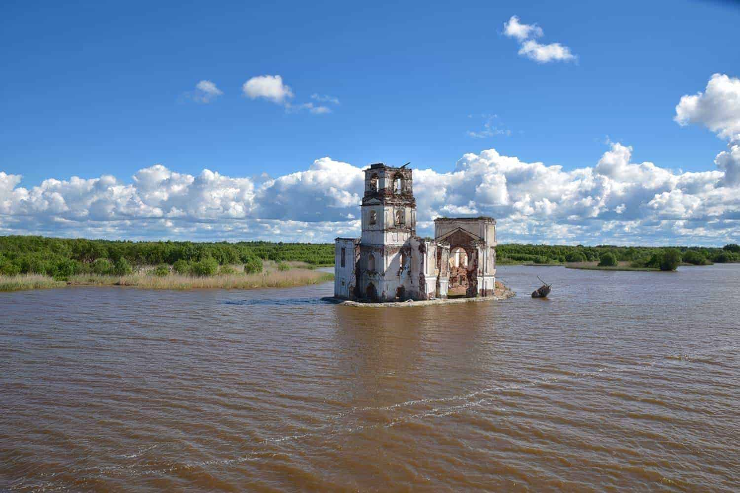 abandoned church in the middle of the river.  one of the unique things you will see on a Waterways Of The Tsars. St Petersburg to Moscow river cruise with viking river cruise.