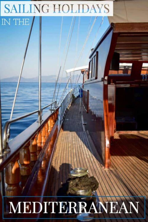Looking down the side deck of a beautiful timber yacht in the Mediterranean.