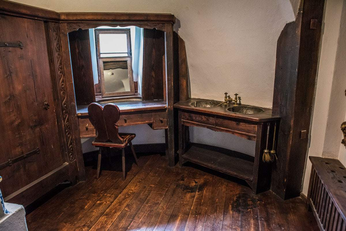 a dressing table, chair and mirror in dracula's castle romania, best things to see and do in romania