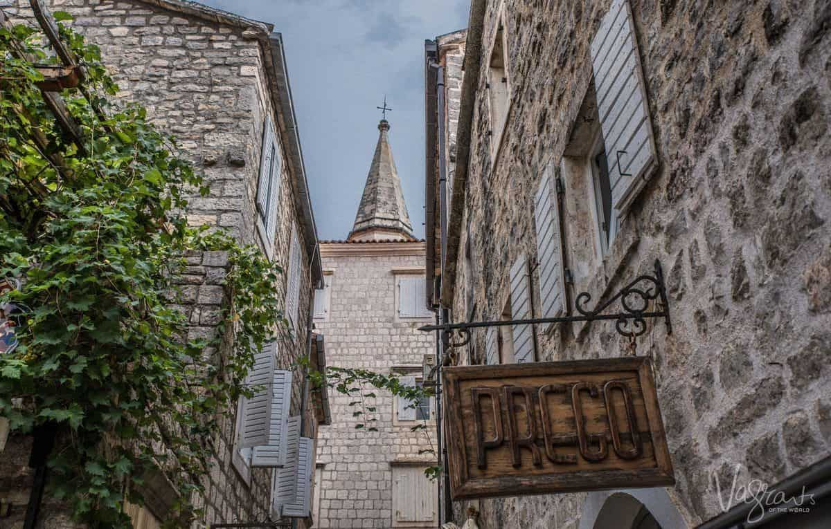Church steeple seen from the lanes of Budva old town Montenegro