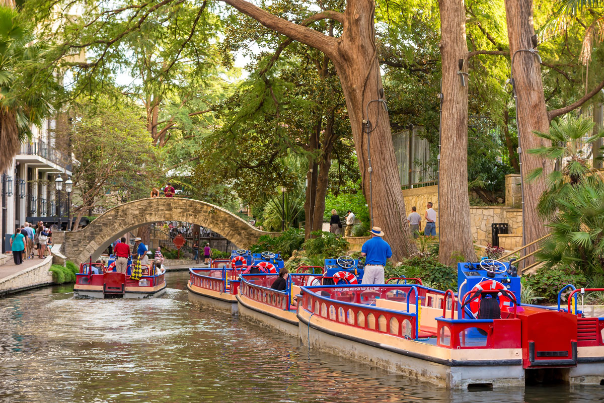 Colourful barges on the San Antonio River Walk