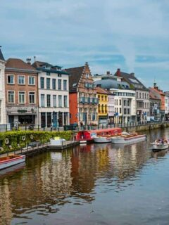 best things to do in Ghent, visit the canals of Ghent with canal boats tied up in the old city. Canal boat tours are one of the most popular things to do in Ghent. This is why visiting Ghent is one of the best things to do in Belgium