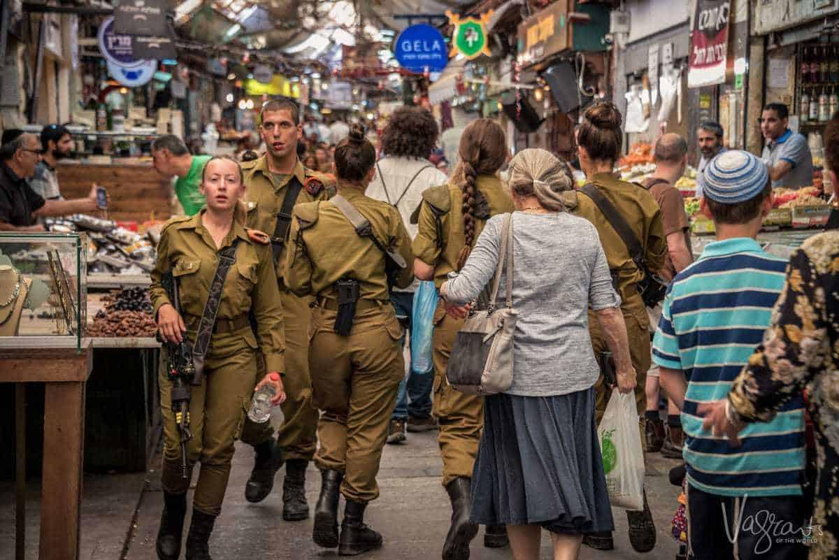 Photos of Israel - Military cadets walk through Jerusalem market