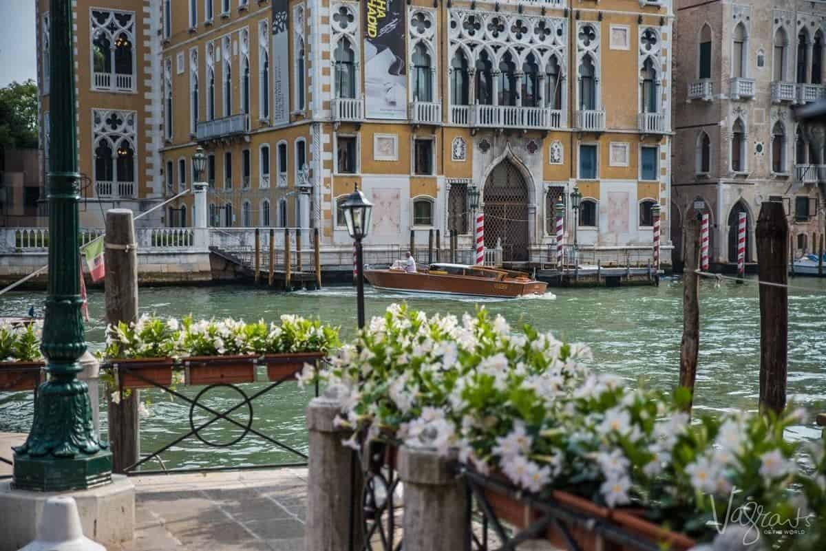 A luxury speed boat travelling down thehe Venice Grand Canal