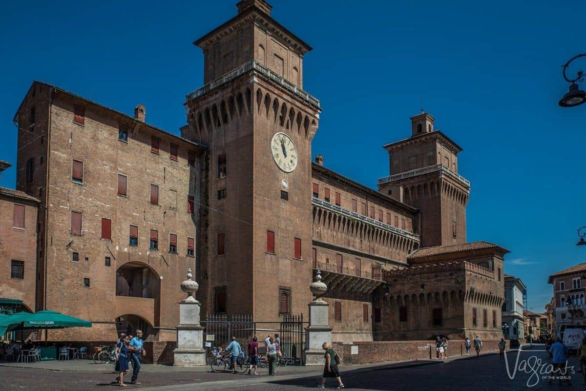 Historic clock tower on the square of Ferrara Italy.