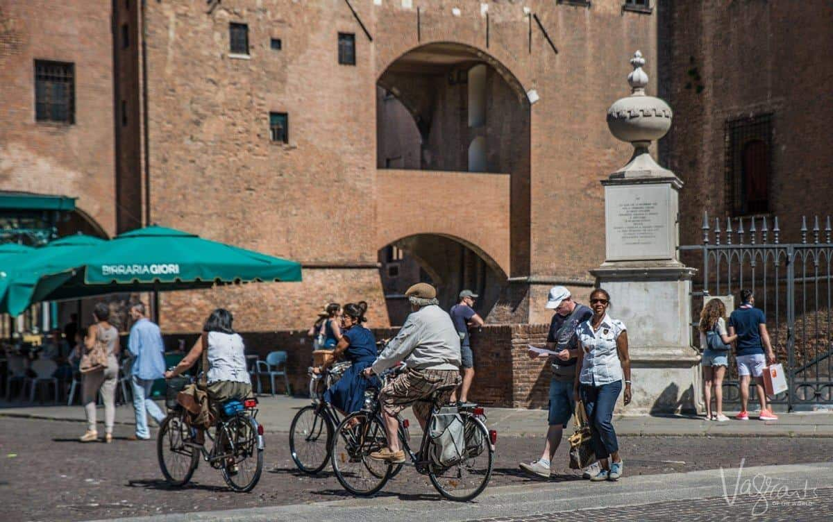 People walking in the ancient streets of Ferrara Italy.