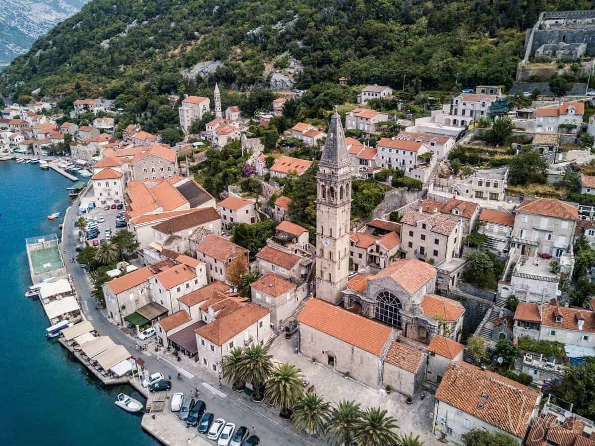 Aerial view of the town of Persat with typical red roofs on the Bay of Kotor Montenegro.