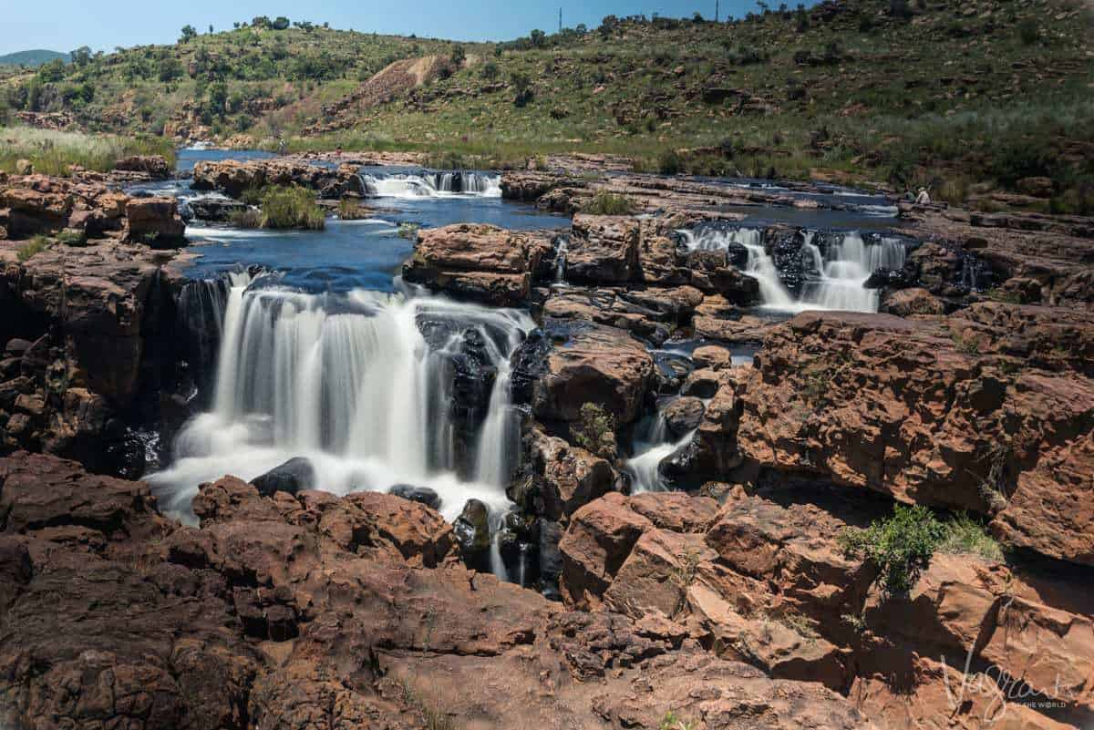 A ground level view of the water flowing across the rock formations at Bourke's Luck Potholes Panorama Route South Africa.