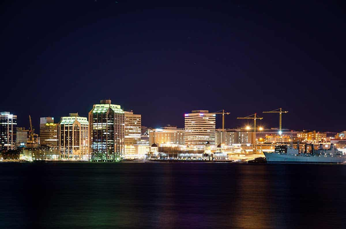 Looking across the water of the port towards the lit up city of Halifax. Best cities to visit in Canada - Halifax Nova Scotia