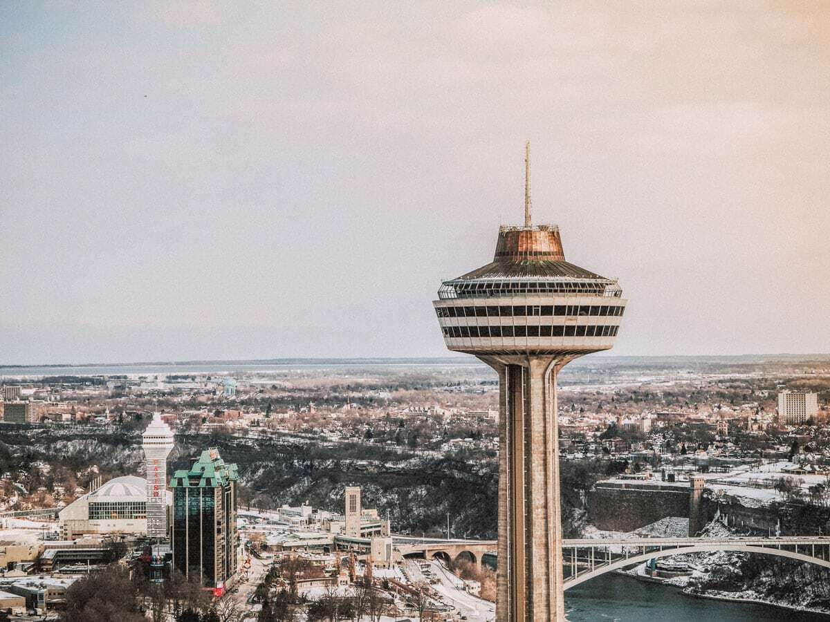 The observation deck of the Skylon Tower in Niagara Falls City with the view across the tower down over the city and river. This is one of the best places to visit in Canada