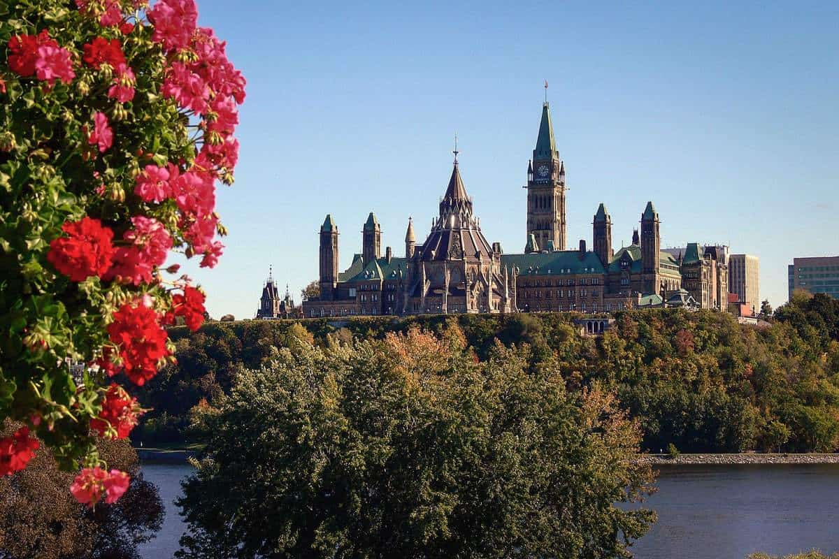 Neo-Gothic structures of Parliament Hill overlooking the Ottawa River. Parliament building Ottawa a must to include in the best things to do in Canada itinerary.