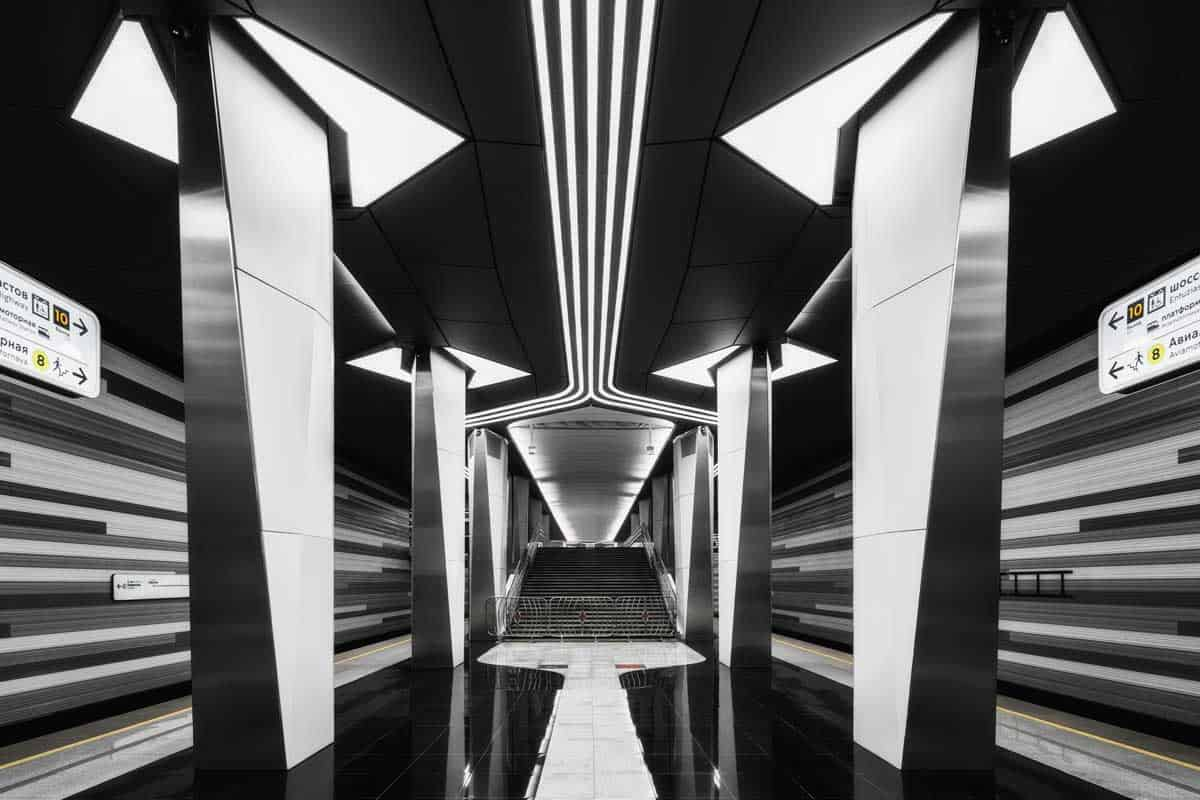 The sleek black and white design on the platforms of Aviamotornaya Station is designed to represent the movement of jet streams.
