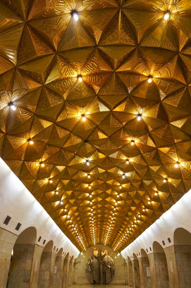 The gold pyramid ceiling in Aviamotornaya Station on the Moscow Metro.