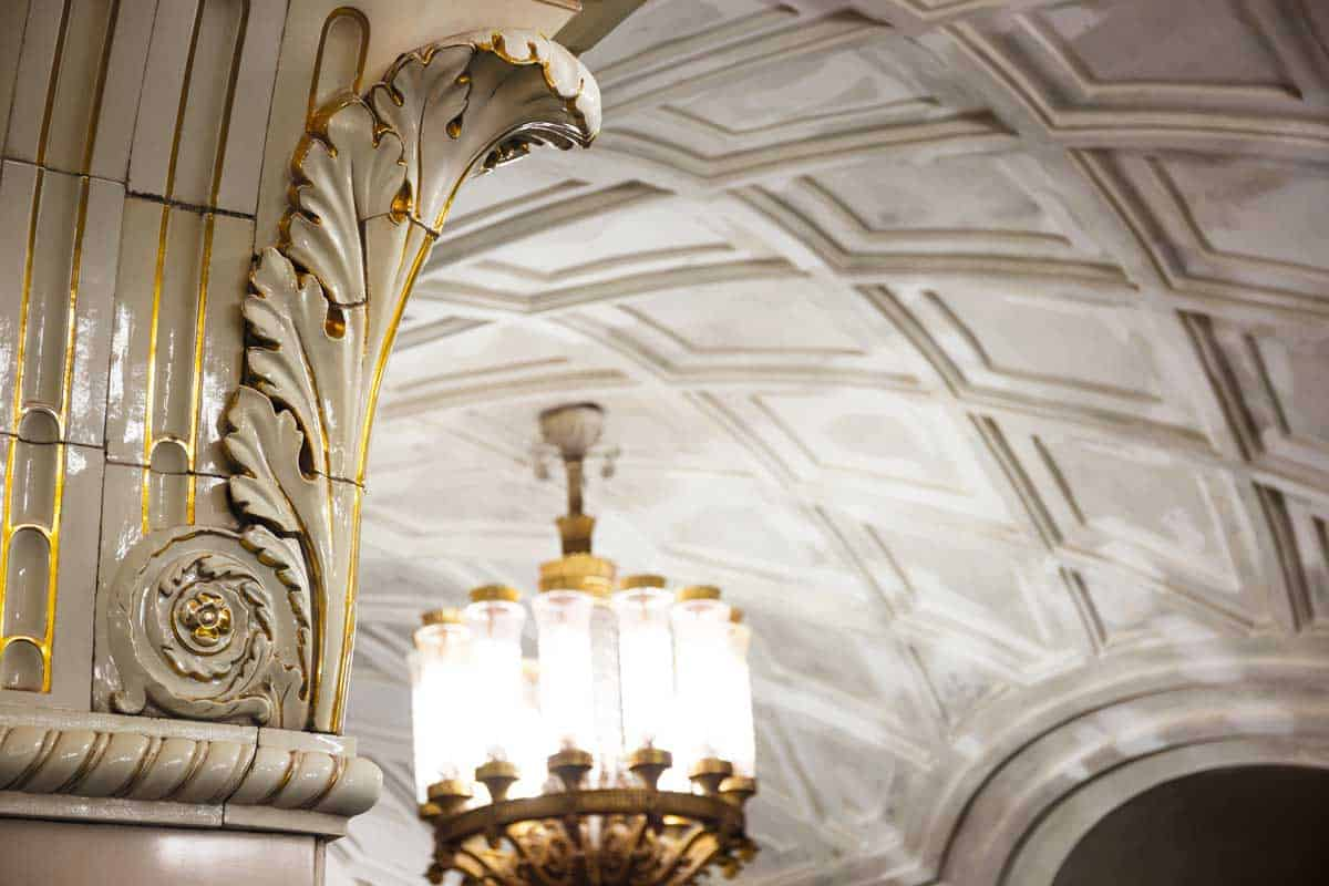 Close up of the ceramic bas reliefs and chandeliers in Prospekt Mira Station In Moscow.
