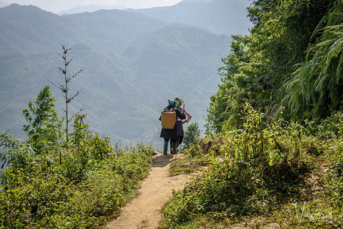 Local women hiking in Sapa mountains Vietnam