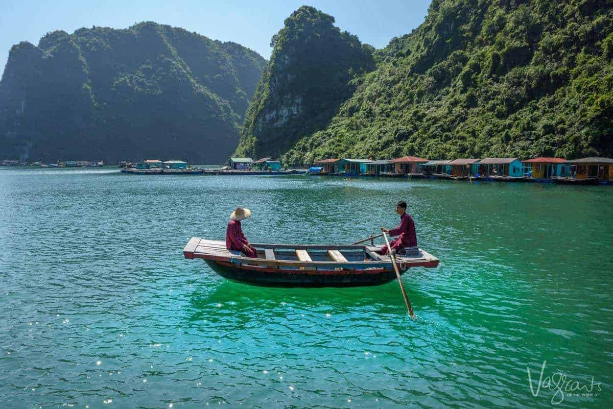 Local men in a row boat in Halong Bay