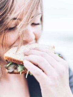 Healthy eating. Woman eating salad sandwich