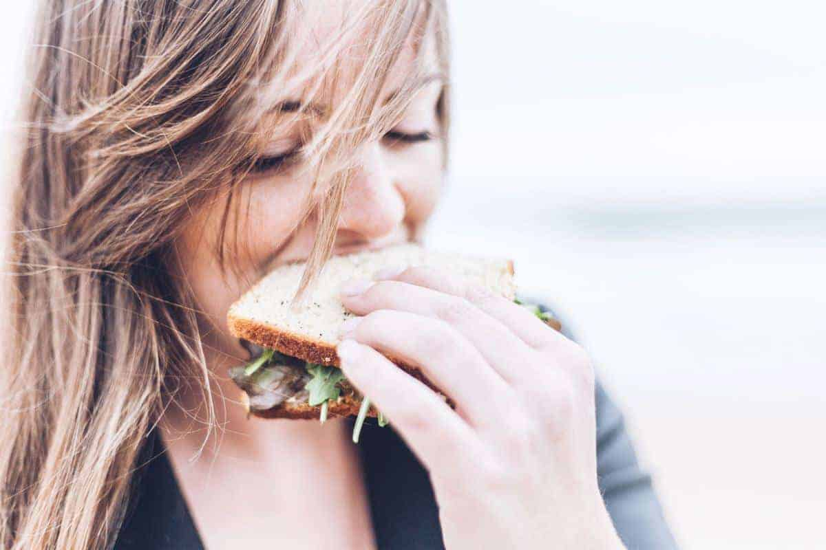 Healthy eating. Woman eating salad sandwich